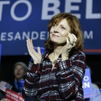 Actress, Susan Sarandon watches as Democratic presidential candidate, Sen. Bernie Sanders, I-Vt, speaks during a campaign event at Music Man Square, Wednesday, Jan. 27, 2016 in Mason City, Iowa. (AP Photo/Chris Carlson)